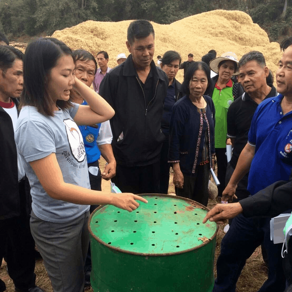 person teaching how to make biochar products to people